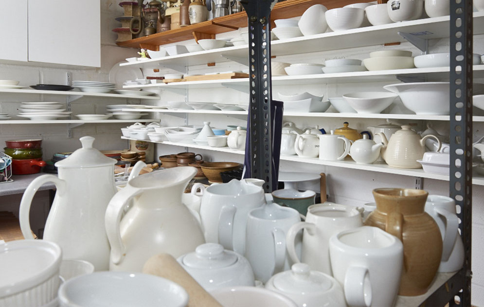 crockery plates and cups in a prop store ready for a food video